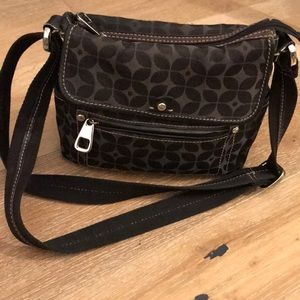 Fossil crossbody bag with heavy magnetic closure